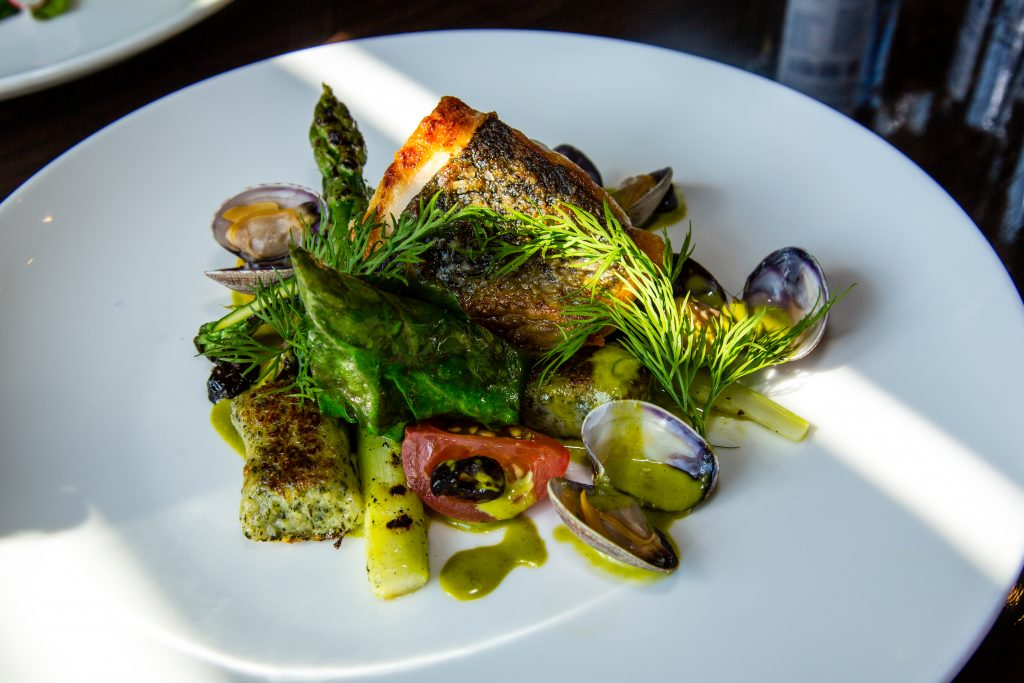 Seabass, clams, gnocchi, asparagus, heritage tomato, olive, herb veloute Jeremy's restaurant