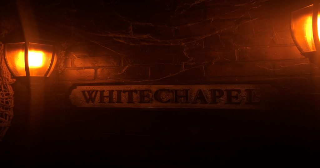 Staged Whitechapel sign with lampposts - article on Title Sussex www.titlesussex.co.uk